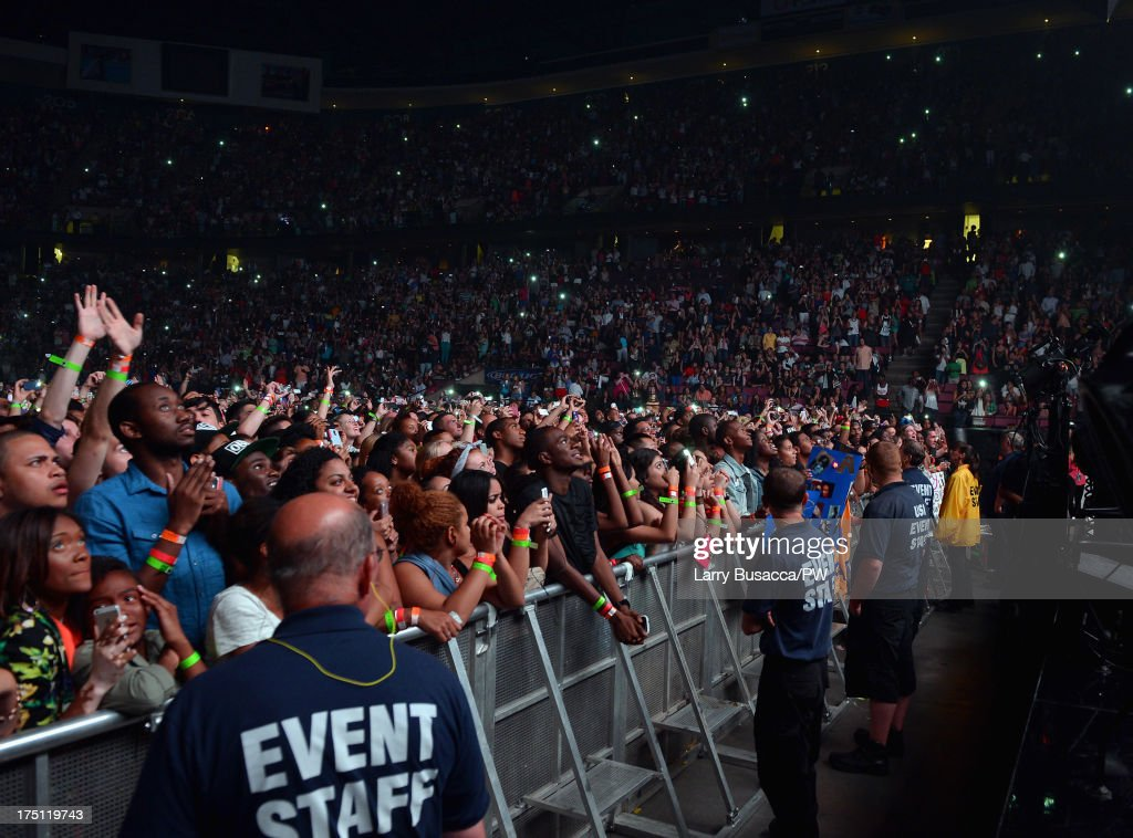 Fans attend 'The Mrs. Carter Show World Tour' at the Izod Center on July 31, 2013 in East Rutherford, New Jersey. Beyonce wears a custom hand beaded white peplum one piece by Ralph & Russo, Stuart Weitzman shoes and hosiery by Capezio.