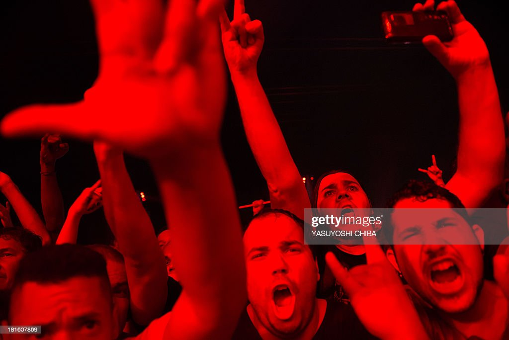 Fans attend the performance of US thrash metal band Slayer during the final day of the Rock in Rio music festival in Rio de Janeiro, Brazil, on September 22, 2013. AFP PHOTO / YASUYOSHI CHIBA