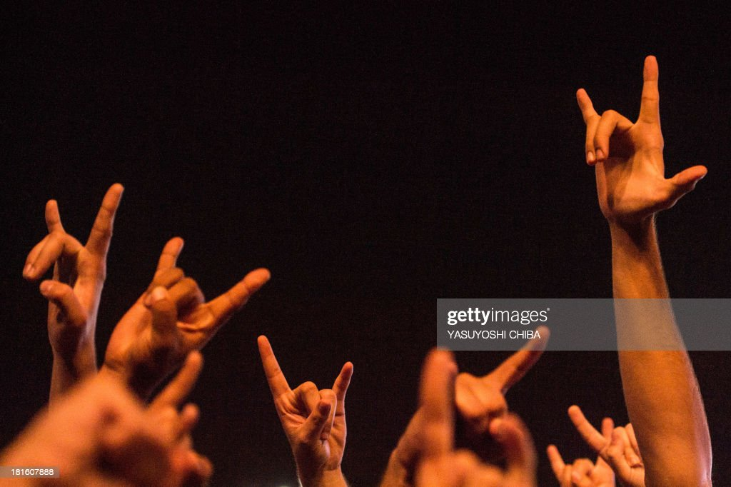 Fans attend the performance of US thrash metal band Slayer during the final day of the Rock in Rio music festival in Rio de Janeiro, Brazil, on September 22, 2013.