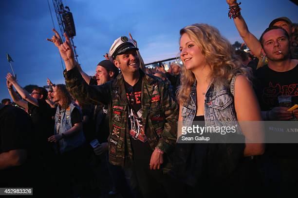Fans attend the Saxon performance at the 2014 Wacken Open Air heavy metal music festival on on July 31 2014 in Wacken Germany Wacken is a village in...