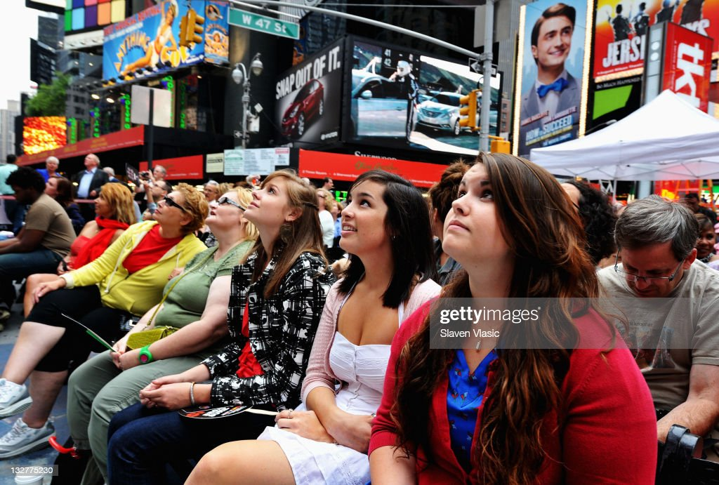 Fans attend the Times Square simulcast of the 65th Annual Tony Awards in Times Square on June 12, 2011 in New York City.