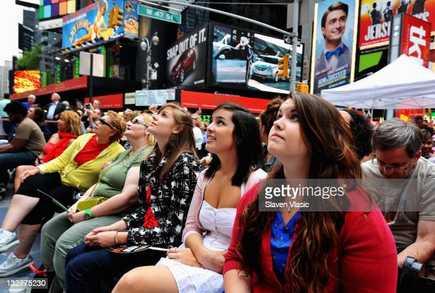 Fans attend the Times Square simulcast of the 65th Annual Tony Awards in Times Square on June 12 2011 in New York City