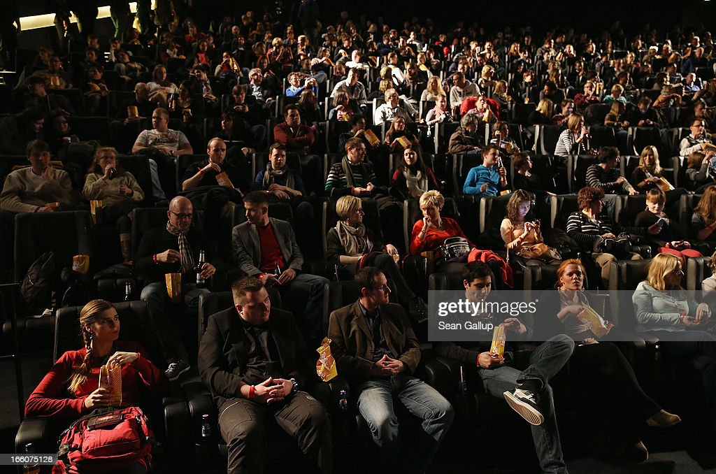 Fans attend the trailer launch event for 'Elysium' at the CineStar on April 8, 2013 in Berlin, Germany.