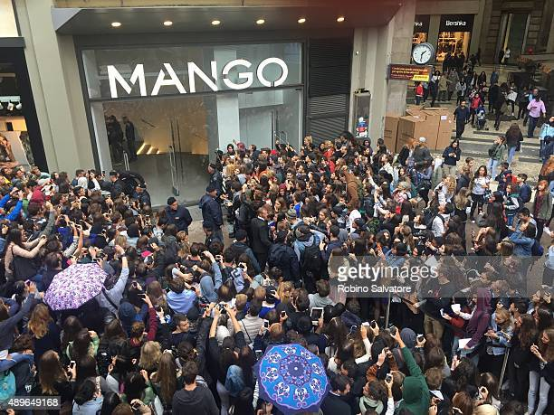 Fans await Cara Delevingne and Kate Moss outside Mango store on September 23 2015 in Milan Italy