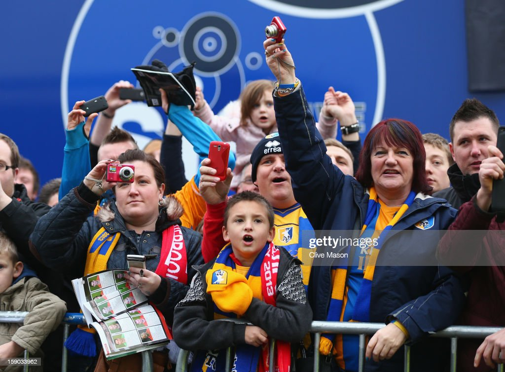 Fans await the arrival of the teams before the FA Cup with Budweiser Third Round match between Mansfield Town and Liverpool at One Call Stadium on January 6, 2013 in Mansfield, England.