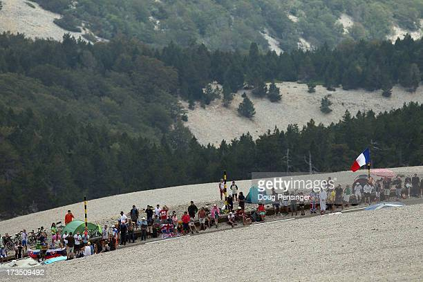 Fans await the cyclists on the slopes of the mountain during stage fifteen of the 2013 Tour de France a 2425KM road stage from Givors to Mont Ventoux...