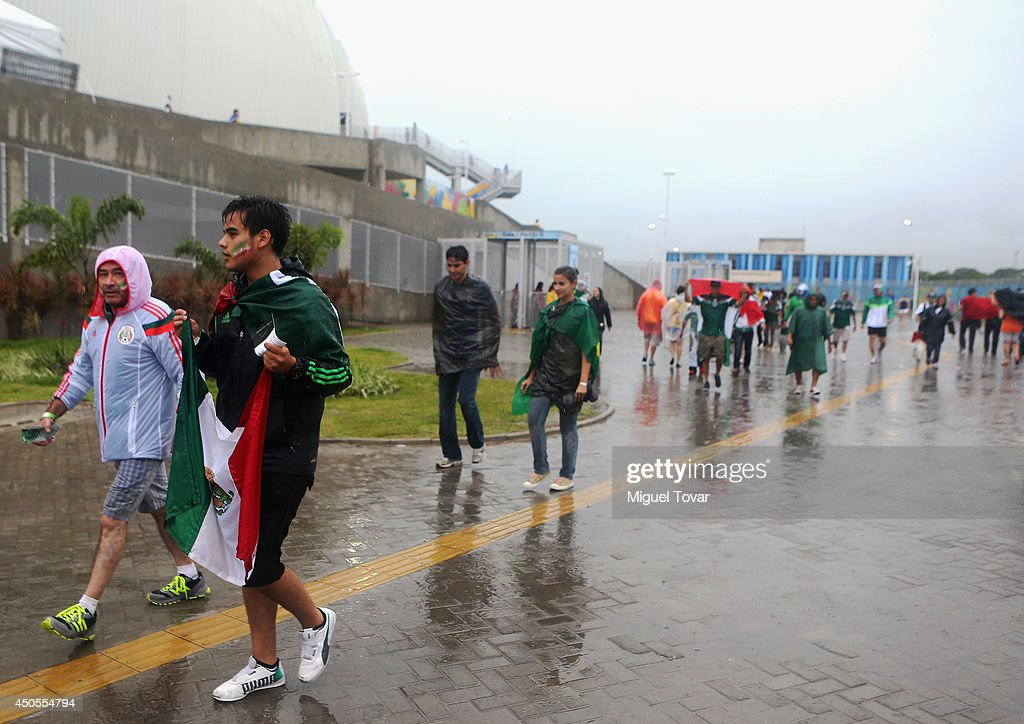 Fans brave the rain before the 2014 FIFA World Cup Brazil Group A match between Mexico and Cameroon at Estadio das Dunas on June 13, 2014 in Natal, Brazil.