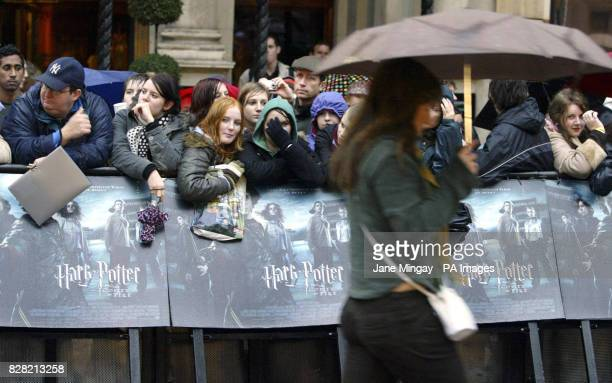 Fans brave the rain outside the Odeon cinema in London's Leicester Square in anticipation of the arrivals for the world premiere of the new film...