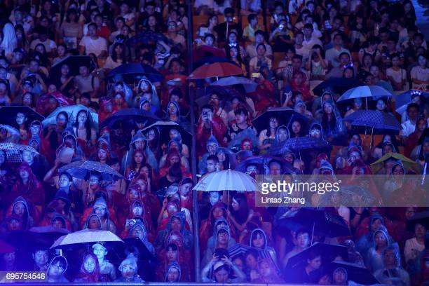 Fans brave the rain to attend the 'Transformers The Last Knight' China World Premiere and Ten Year Anniversary Celebration at Haixinsha Asian Olympic...