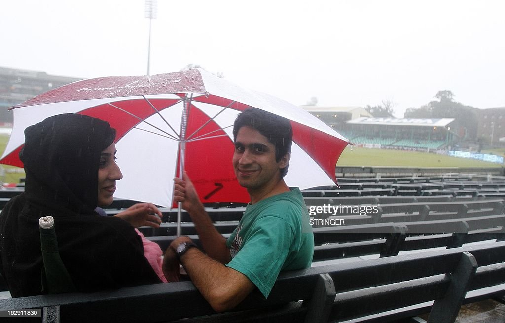 Fans braved the rain on March 1, 2013 at Sahara Stadium in Durban, South Africa. Steady rain threatened to wash out the first Twenty20 international between South Africa and Pakistan at Kingsmead here on Friday.