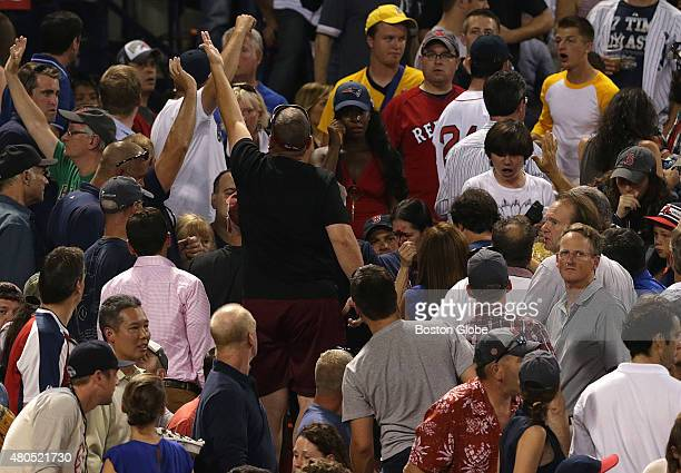 Fans call for medical attention after fan in the stands was bloodied by a foul line drive The Boston Red Sox take on the New York Yankees in Game 1...