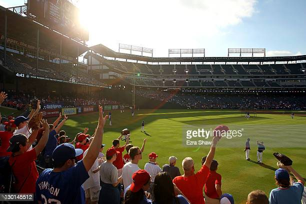Fans call out for baseballs during batting practice prior to Game Four of the MLB World Series between the St Louis Cardinals and the Texas Rangers...