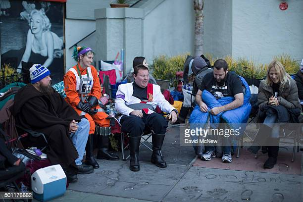 Fans camp out among the concrete handprints and footprints of the TLC Chinese Theatre courtyard for the premiere of Walt Disney Pictures And...