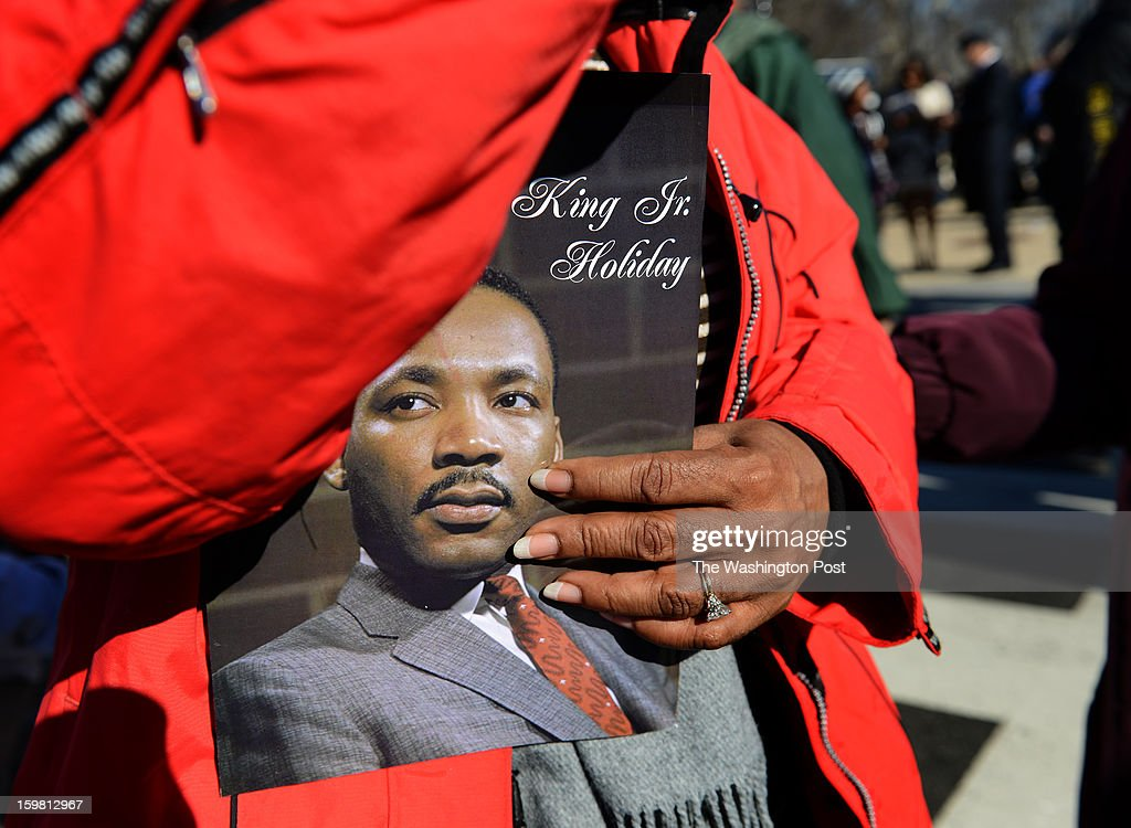 Fans carry memorial pamphlets of MLK at the Wreath-Laying Ceremony at the Martin Luther King Jr. Memorial in Washington, DC on January 20, 2013. It's the first wreath-laying ceremony since the Memorial was dedicated. Thousands flocked to the area today to pay tribute to the civil rights leader and his legacy. Notables at the ceremony were MLK's oldest son, Martin Luther King III, actor Jamie Foxx, The Rev. Al Sharpton, and Rev. Jesse Jackson.