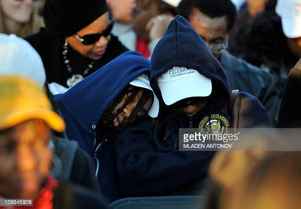 Fans catch a little sleep before the start of the Martin Luther King Jr Memorial Dedication ceremony in Washington DC in the early morning hours...