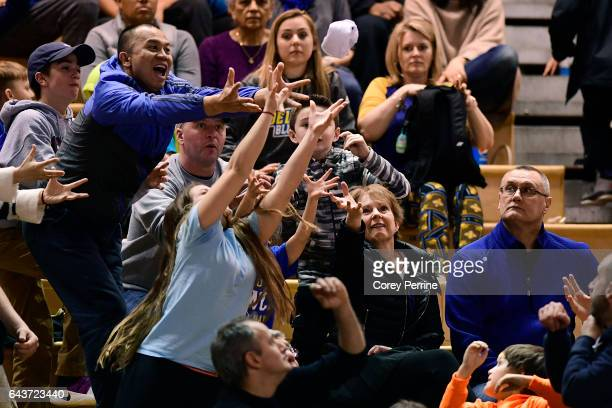 Fans catch a tshirt tossed into the audience during the second half as the Delaware Fightin Blue Hens hosts the William Mary Tribe at the Bob...