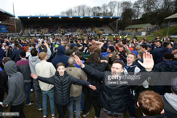 Fans celebarate after FC Halifax Town defeat Nantwich Town FC during the FA Trophy Semi Final Second Leg match between FC Halifax Town and Nantwich...