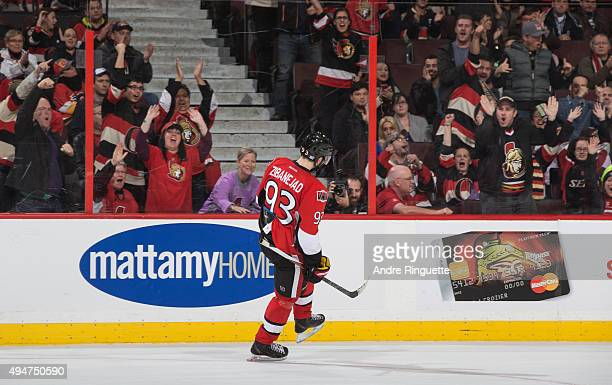 Fans celebrate a shootout goal by Mika Zibanejad of the Ottawa Senators against the Calgary Flames at Canadian Tire Centre on October 28 2015 in...