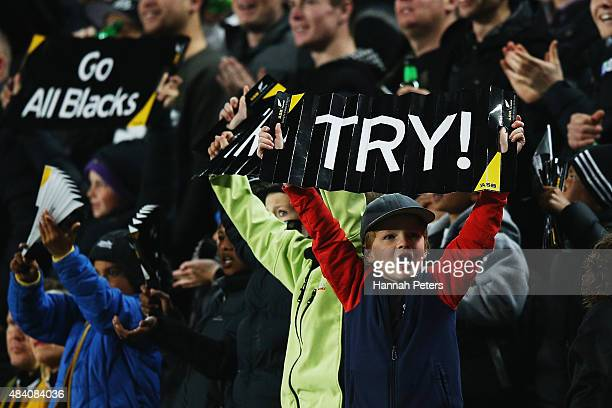 Fans celebrate a try during The Rugby Championship Bledisloe Cup match between the New Zealand All Blacks and the Australian Wallabies at Eden Park...