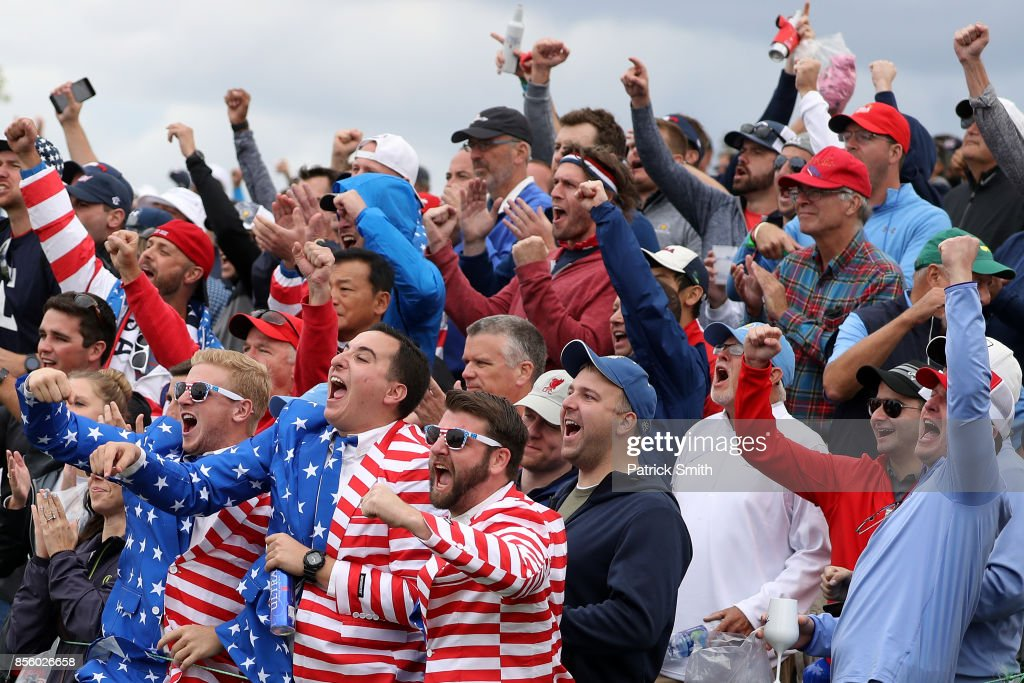 Fans celebrate a U.S. Team putt during Saturday afternoon four-ball matches of the Presidents Cup at Liberty National Golf Club on September 30, 2017 in Jersey City, New Jersey.