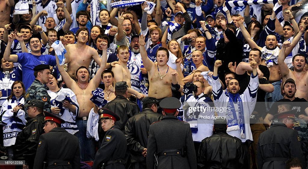 Fans celebrate after Dinamo Moscow defeats Traktor Chelyabinsk at the final play-off game during the KHL Championship 2012/2013 on April 18, 2013 at the Arena Traktor in Chelyabinsk, Russia.