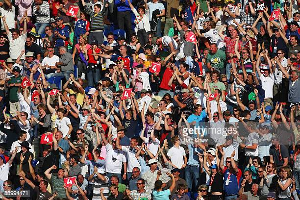 Fans celebrate after England secured the draw during day five of the npower 1st Ashes Test Match between England and Australia at the SWALEC Stadium...