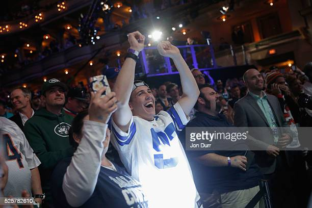 Fans celebrate after Ezekiel Elliott of Ohio State was picked overall by the Dallas Cowboys during the first round of the 2016 NFL Draft at the...