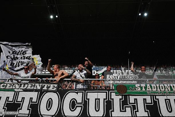 Fans celebrate after Lars Stindl of Borussia Moenchengladbach scores his teams first goal of the game during the Bundesliga match between Borussia...