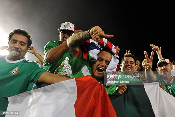 Fans celebrate after Mexico defeated the United States in the 2017 FIFA Confederations Cup Qualifier at Rose Bowl on October 10 2015 in Pasadena...