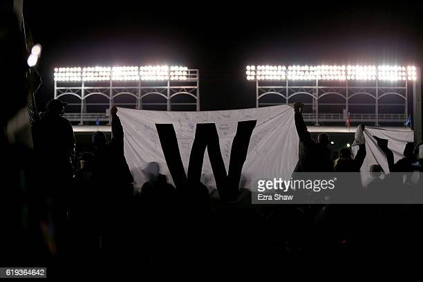 Fans celebrate after the Chicago Cubs beat the Cleveland Indians 32 in Game Five of the 2016 World Series at Wrigley Field on October 30 2016 in...