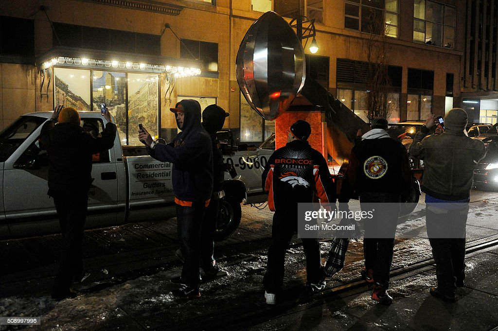 Fans celebrate after the Denver Broncos win in Super Bowl 50 in Denver, Colorado on February 8, 2016. Broncos fans gathered around Denver to cheer on the team as they took on the Carolina Panthers in Super Bowl 50.