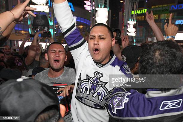 Fans celebrate after the Los Angeles Kings beat the New York Rangers in Game 5 to win the Stanley Cup on June 13 2014 in Los Angeles California It is...
