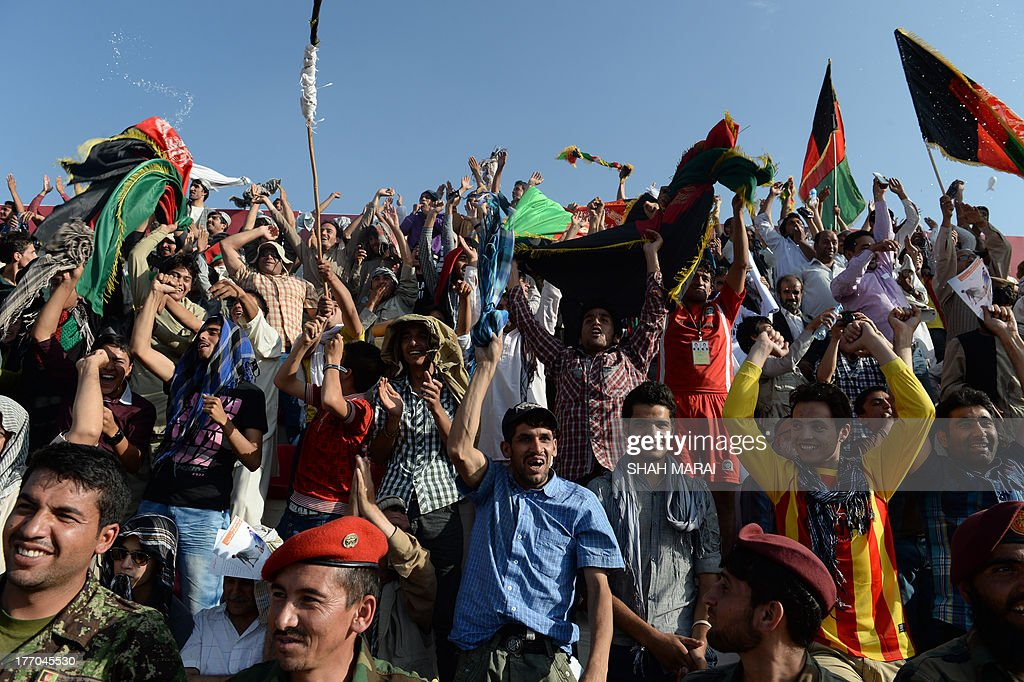 Fans celebrate after their team beat 3-0 win against Pakistan at the Afghanistan Football Federation (AFF) stadium in Kabul on August 20, 2013. Afghanistan's football team sparked rowdy celebrations across the war-battered nation on August 20 after securing an convincing 3-0 win over arch-rivals Pakistan in the first international match in Kabul for ten years. AFP PHOTO/ SHAH Marai