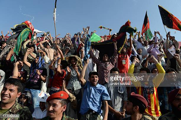 Fans celebrate after their team beat 30 win against Pakistan at the Afghanistan Football Federation stadium in Kabul on August 20 2013 Afghanistan's...