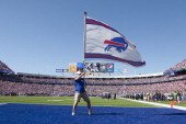 Fans celebrate and the end zone flag is waived after a touchdown scored by Freddie Jackson of the Buffalo Bills against the Philadelphia Eagles at...