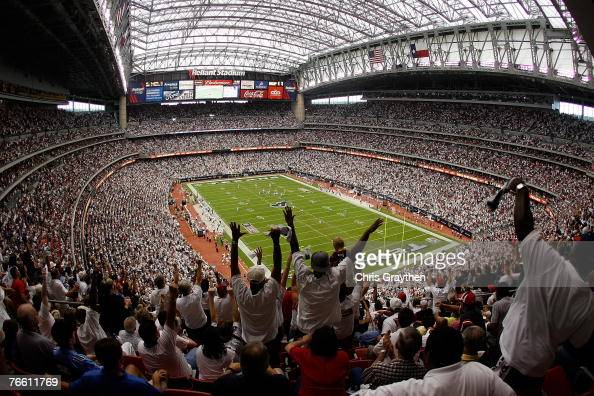 Fans celebrate as Andre Johnson of the Houston Texans scores a touchdown against the Kansas City Chiefs at Reliant Stadium September 9 2007 in...