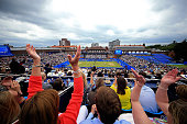 Fans celebrate as Andy Murray wins the second set during the final of The Aegon Championships on day seven at The Queens Club on June 19 2016 in...
