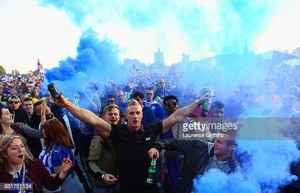 Fans celebrate as Kasabian play a live set during the Leicester City Barclays Premier League winners bus parade on May 16 2016 in Leicester England