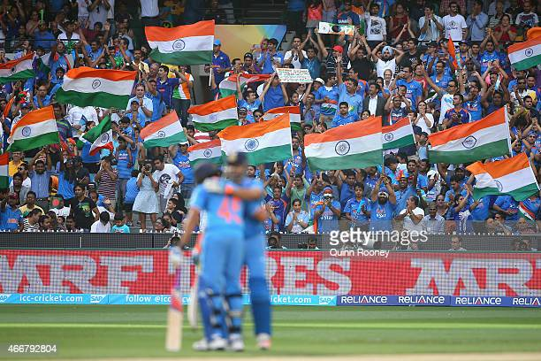 Fans celebrate as Suresh Raina of India celebrates making 50 runs during the 2015 ICC Cricket World Cup Quater Final match between India and...