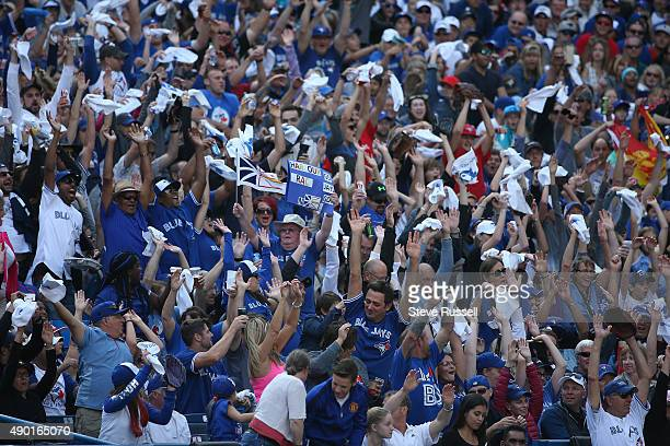 TORONTO ON SEPTEMBER 26 Fans celebrate as the playoff bound Toronto Blue Jays beat the Tampa Bay Rays 108 at Rogers Centre in Toronto September 26...
