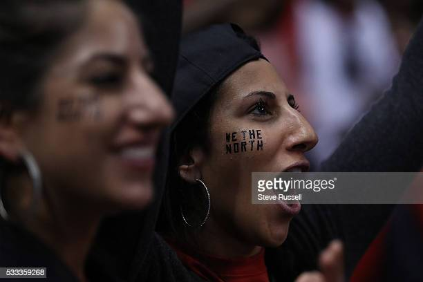 Fans celebrate as the Toronto Raptors beat the Cleveland Cavaliers in game 3 of the NBA Conference Finals at the Air Canada Centre in Toronto May 21...