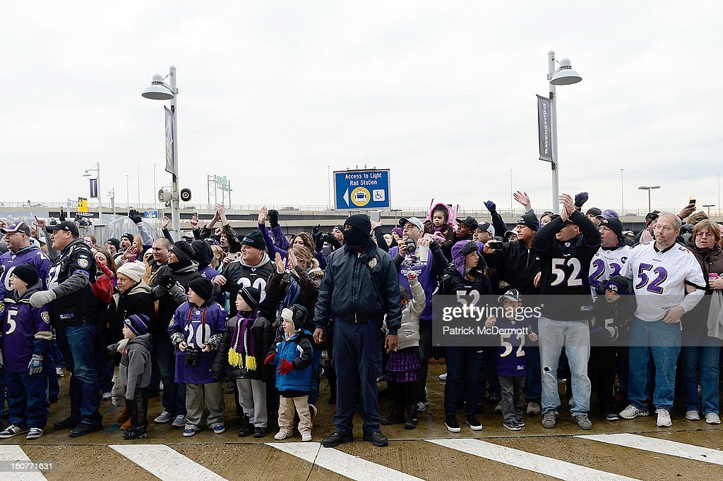Fans celebrate before the start of the Baltimore Ravens Super Bowl XLVII victory parade at M&T Bank Stadium on February 5, 2013 in Baltimore, Maryland. The Baltimore Ravens captured their second Super Bowl title by defeating the San Francisco 49ers.