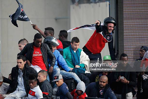 PSG fans celebrate by climbing on cars buildings and scaffolding in front of Musee d'Ethnographie du Trocadero or Ethnographic Museum of the...