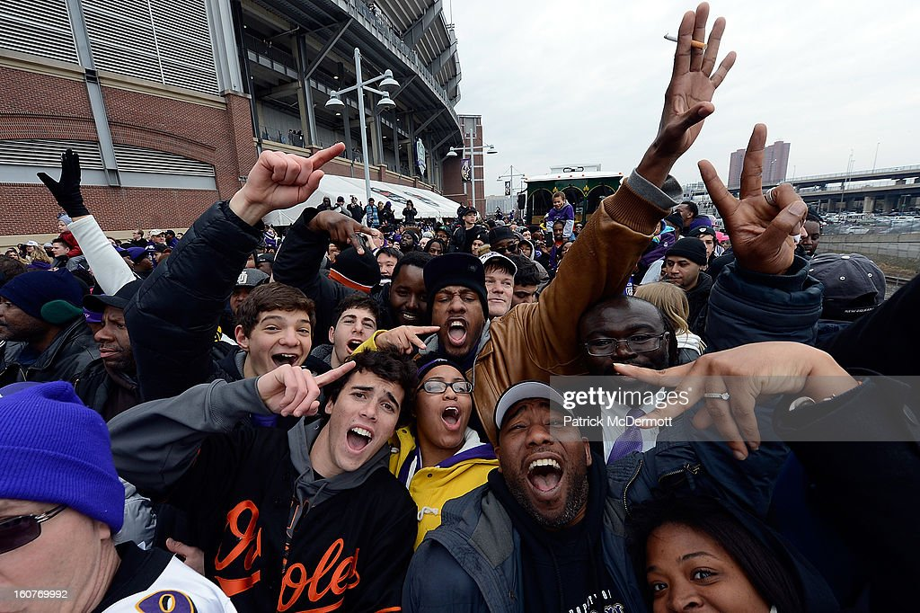 Fans celebrate during the Baltimore Ravens Super Bowl XLVII victory parade on February 5, 2013 in Baltimore, Maryland. The Baltimore Ravens captured their second Super Bowl title by defeating the San Francisco 49ers.