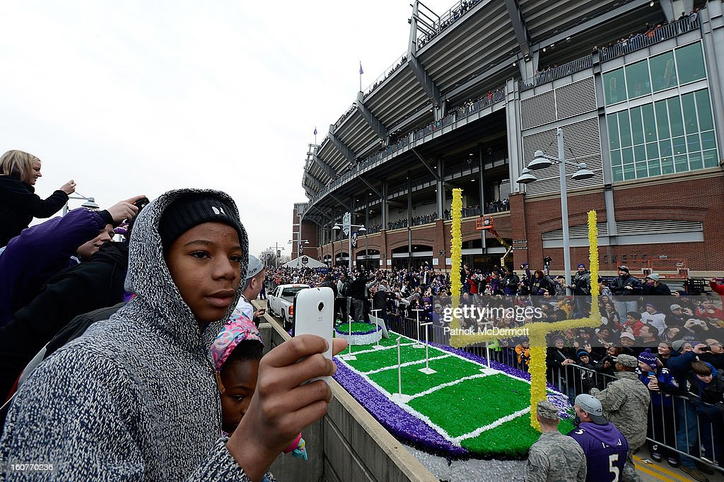 Fans celebrate during the Baltimore Ravens Super Bowl XLVII victory parade at M&T Bank Stadium on February 5, 2013 in Baltimore, Maryland. The Baltimore Ravens captured their second Super Bowl title by defeating the San Francisco 49ers.