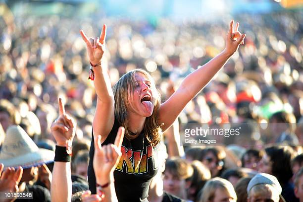 Fans celebrate during the first day of Rock am Ring on June 03 2010 in Nuerburg Germany