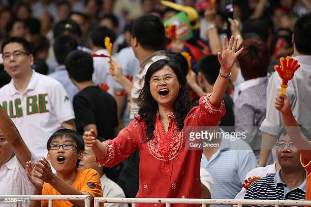 Fans celebrate during the game between the Milwaukee Bucks and the Golden State Warriors at 2008 NBA China Games on October 15 2008 at the Guangzhou...
