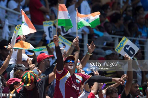 Fans celebrate during the T20 match between West Indies and India at the Sabina Park Cricket Ground in Kingston Jamaica on July 9 2017 / AFP PHOTO /...