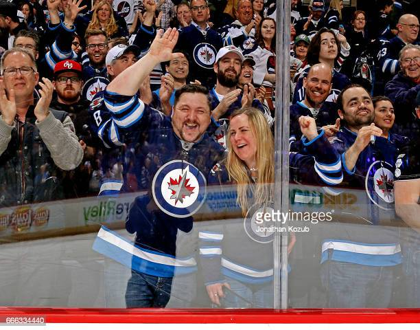 Fans celebrate enthusiastically following a 21 victory by the Winnipeg Jets over the Nashville Predators in the regular season finale at the MTS...