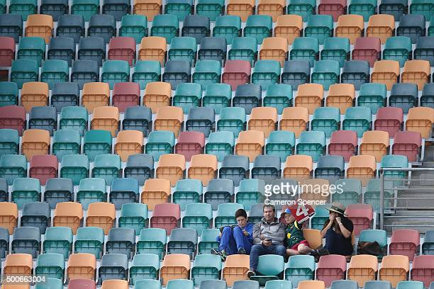 Fans celebrate four runs during day one of the First Test match between Australia and the West Indies at Blundstone Arena on December 10 2015 in...
